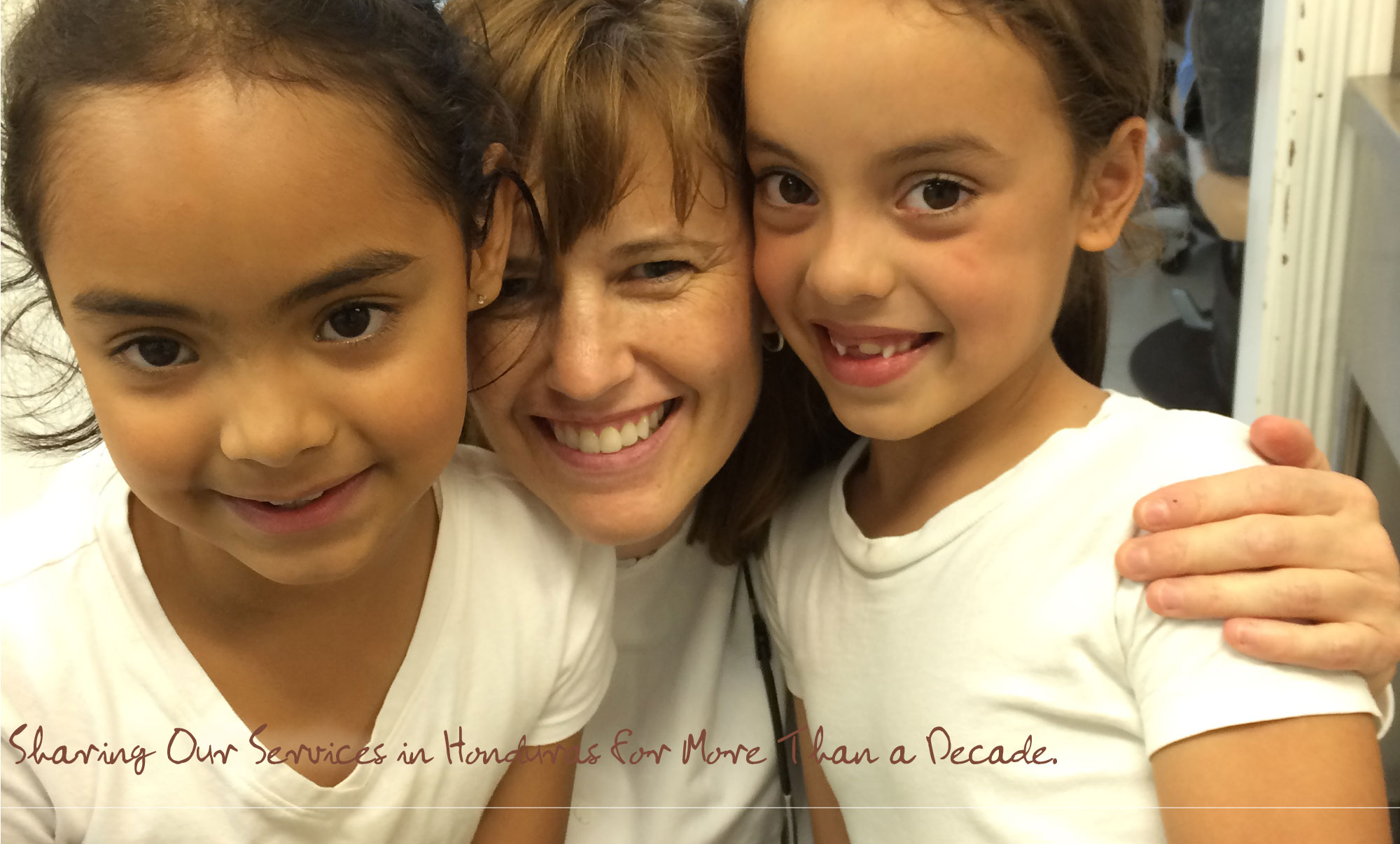 Dr. Kate Schacherl with two young girls